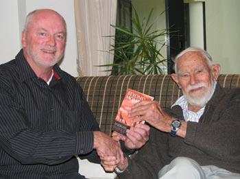 Frank presents a copy of Beyond Mombasa to 96-year-old Brian Goord.